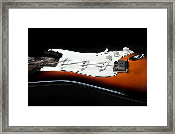 Fender Stratocaster Guitar On Black Background Framed Print