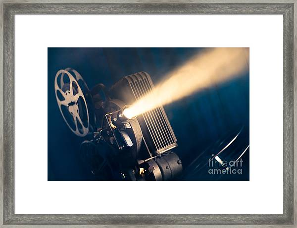 Film Projector On A Wooden Background Framed Print