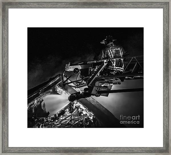Firefighter At Work Framed Print