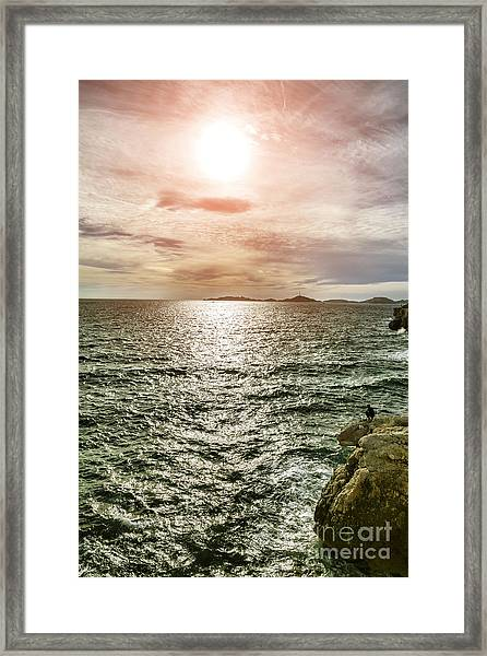 Fisherman On The Cliff At Sunset Framed Print by Pier Giorgio Mariani