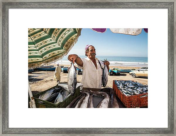 Fisherman Selling His Fish At Market On Framed Print