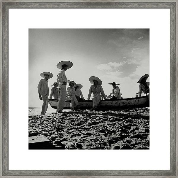 Fishermen On The Beach Of Pia De La Cuesta Framed Print