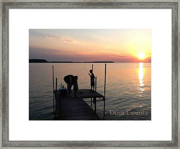 Fishing From The Dock In The Sunset Framed Print