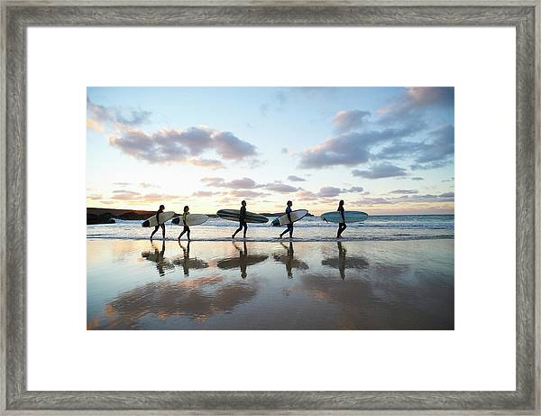 Five Surfers Walk Along Beach With Surf Framed Print by Dougal Waters