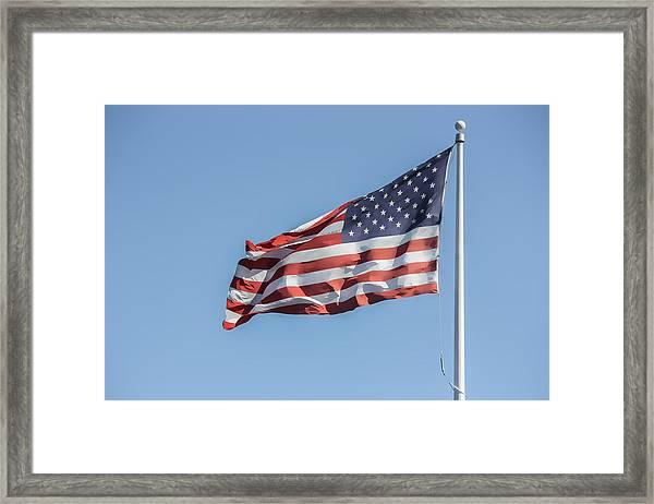 Flag And Blue Sky Framed Print