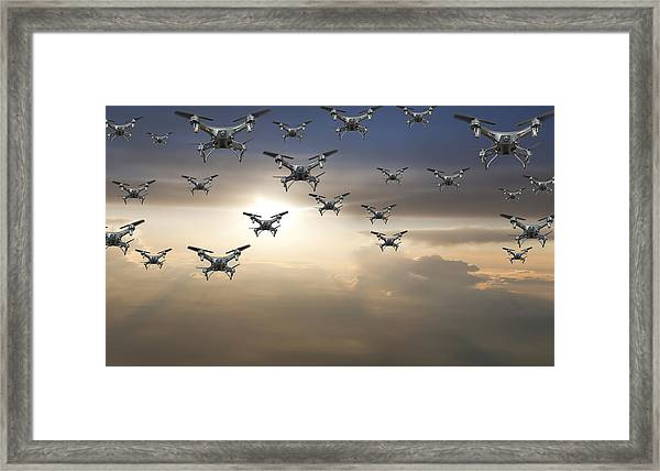 Flock Of Drones In The Sky At Sunset Framed Print by Buena Vista Images