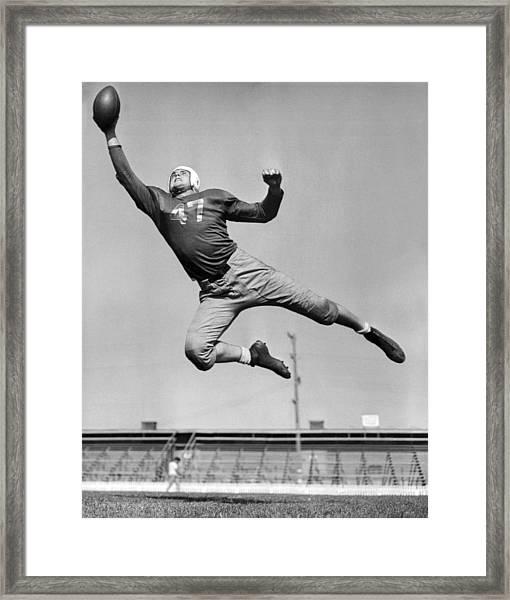 Football Player Catching Pass Framed Print
