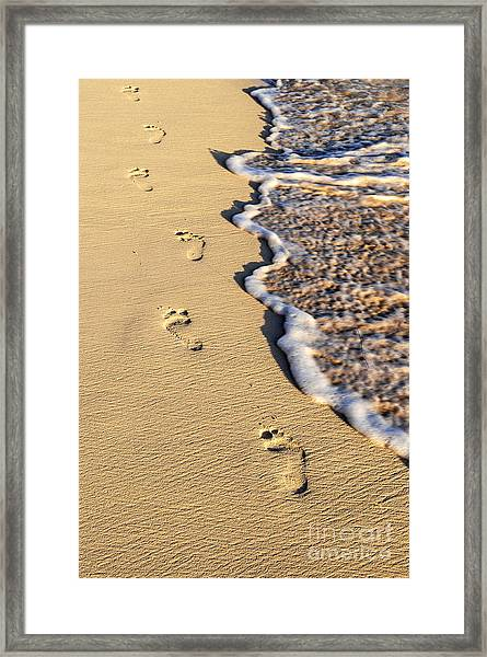 Footprints On Beach Framed Print