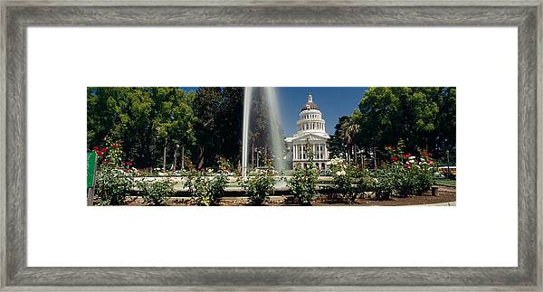 Fountain In A Garden In Front Framed Print