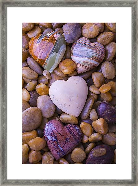 Four Stone Hearts Framed Print