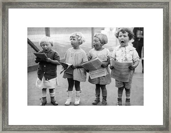 Four Young Children Singing Framed Print