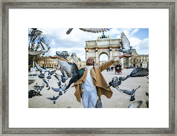 France, Paris, Happy Young Woman With Flying Pidgeons At Arc De Triomphe Framed Print by Westend61