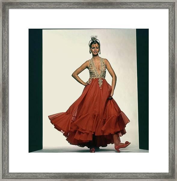 Francoise Rubartelli Wearing A Red Dress Framed Print