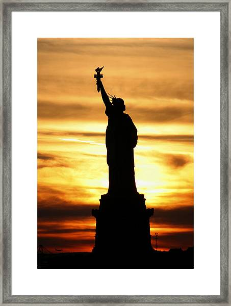 Framed Print featuring the photograph Statue Of Liberty Silhouette by Bob Slitzan