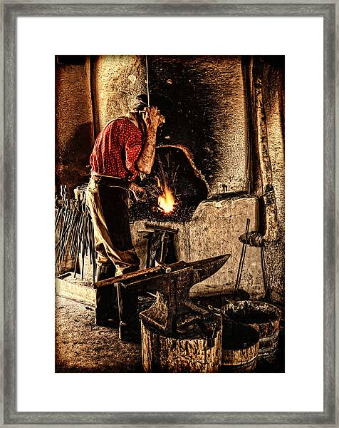 Frontier Blacksmith At The Forge Framed Print