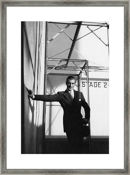Gary Cooper Leaning On A Wall Framed Print