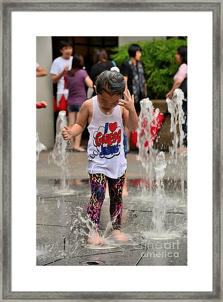 Girl Child Plays With Water At Fountain Singapore Framed Print