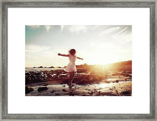 Girl Dancing On Beach At Sunset Sun Rays Framed Print