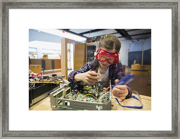 Girl Goggles Assembling Electronics Circuit At Science Center Framed Print by Hero Images