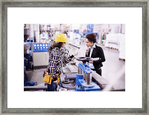 Girl In A Factory Working With Her Woman Boss Framed Print by Milanvirijevic