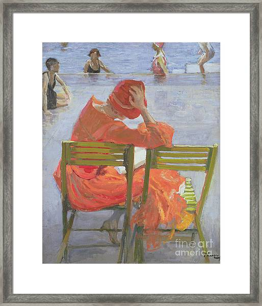 Girl In A Red Dress Reading By A Swimming Pool Framed Print