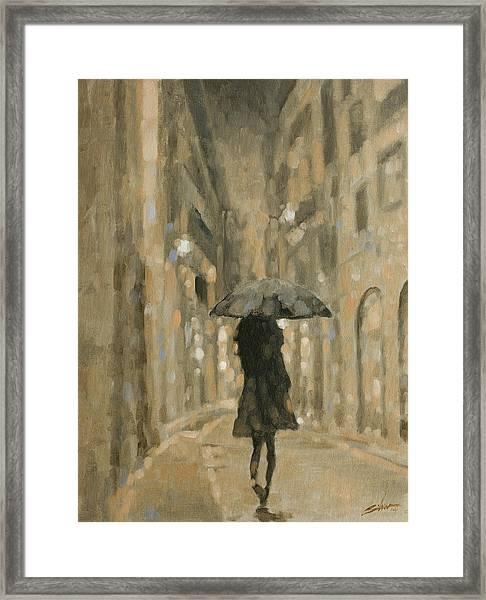 Girl In The Rain Framed Print