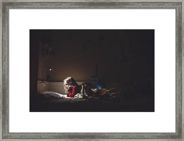 Girl Reading In Her Bed At Night Framed Print by Teresa Short