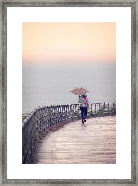 Girl Walking With Umbrella Framed Print