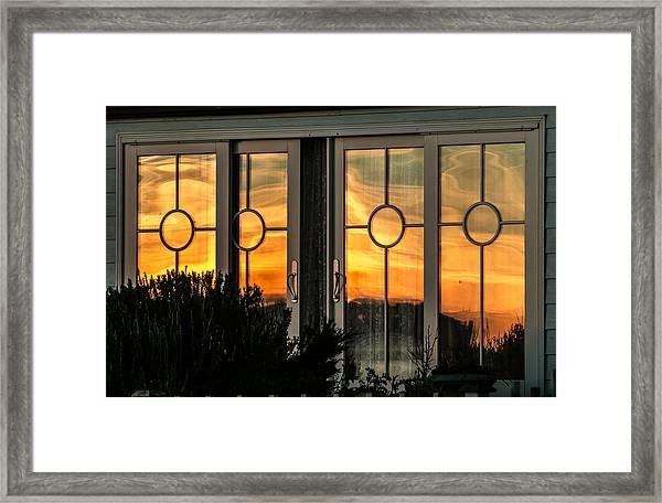 Glass Doors Aglow Framed Print