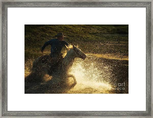 Go Cowboy Framed Print