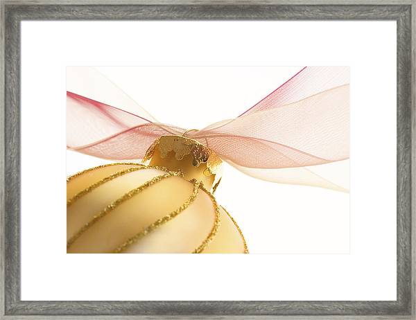 Golden Ornament With Red Ribbon High Key Framed Print