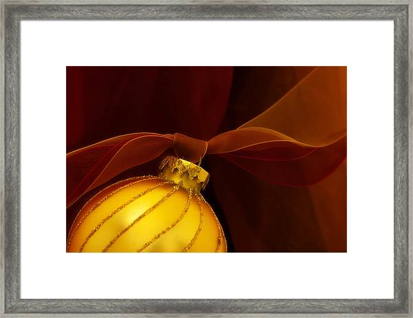 Golden Ornament With Red Ribbons Framed Print
