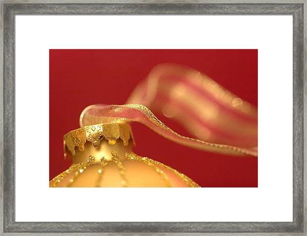 Golden Ornament With Striped Ribbon Framed Print