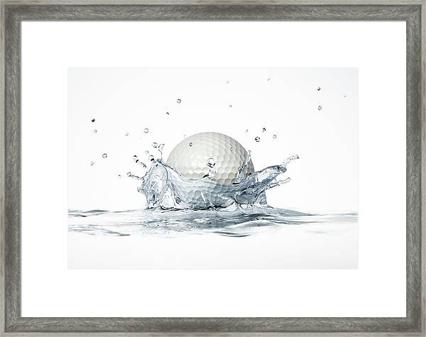 Golf Ball Splashing Into Water Framed Print by Leonello Calvetti