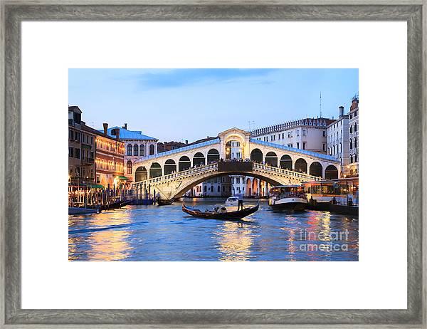 Gondola In Front Of Rialto Bridge At Dusk Venice Italy Framed Print