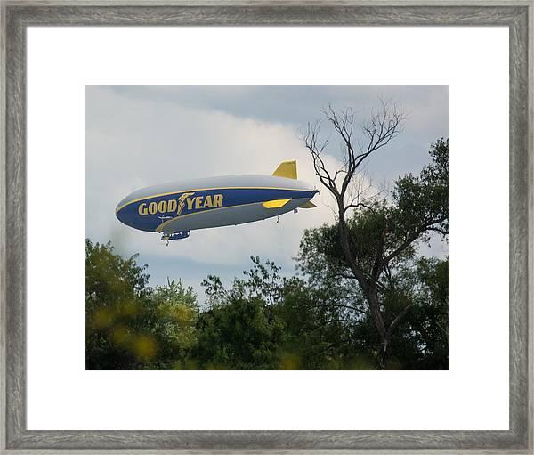 Goodyear Blimp Tree Top Flyer Framed Print