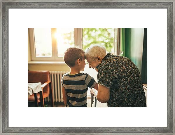 Grandson Visiting His Granny In Nursery Framed Print by Supersizer