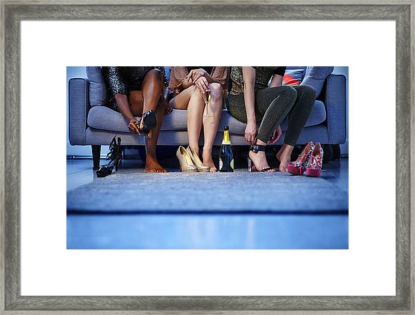 Group Of Women Putting On Heels Before Night Out Framed Print by Mike Harrington