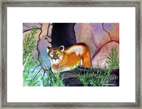 Guarding The Cave Framed Print