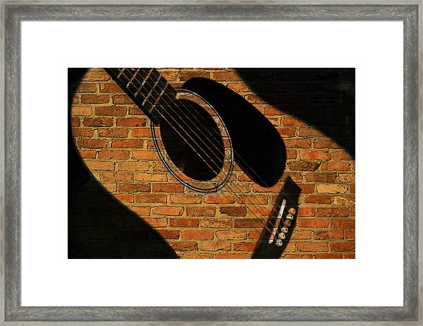 Guitar Shadow Framed Print