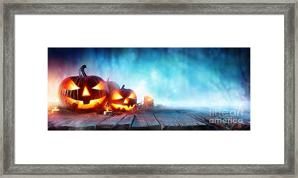 Halloween Pumpkins On Wood In A Spooky Framed Print by Romolo Tavani