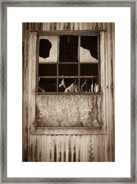 Hangers In The Window Framed Print