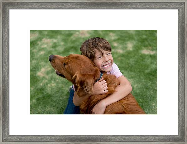 Happy Boy With A Beautiful Dog Framed Print by Andresr