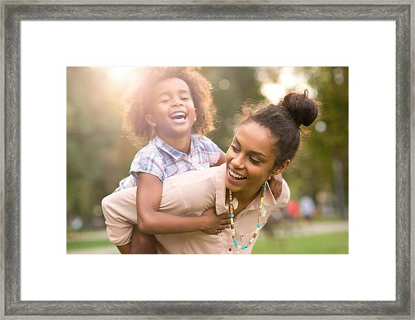Happy Family Enjoying In The Nature. Framed Print by MStudioImages