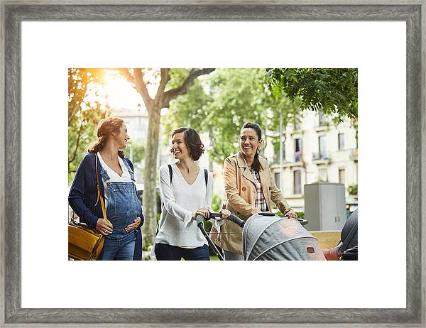 Happy Pregnant Woman With Friends In Park Framed Print by Morsa Images