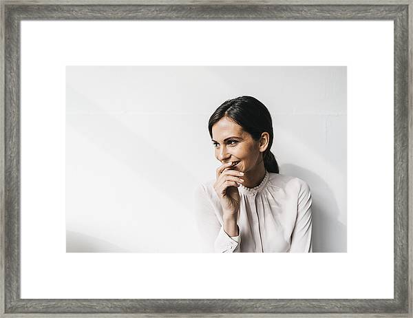 Happy Woman In Front Of White Wall Framed Print by Westend61