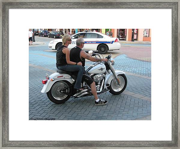 Harley On Main Street Framed Print