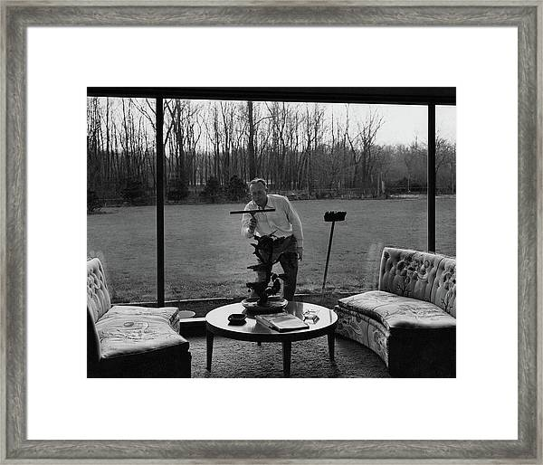 Harold M Sloan Cleaning A Glass Wall Framed Print