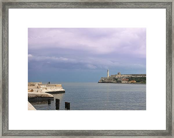 Havana Malecon With Morro Lighthouse And A Lonely, Unrecognizable Person Relaxing By The Sea, Cuba Framed Print by Smartshots International