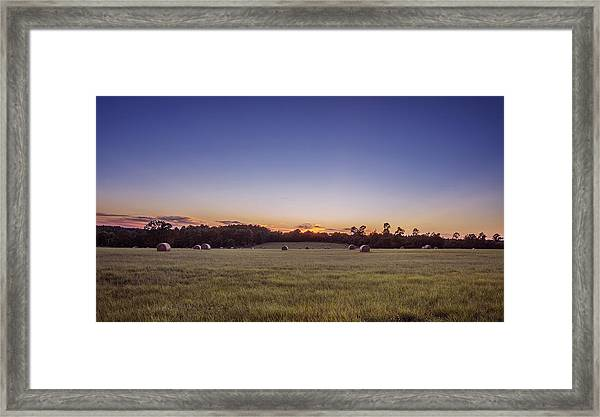 Hay Bales In A Field At Sunset Framed Print